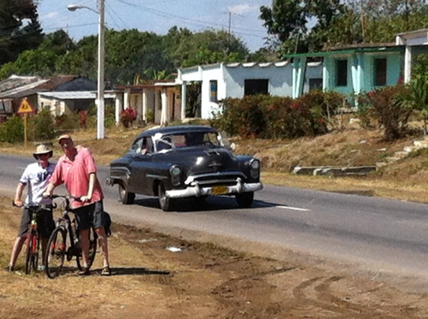 Alex and Steve on a highway in Cuba